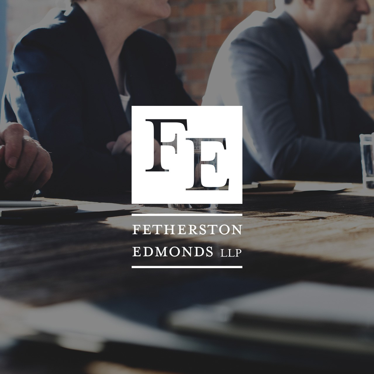board room meeting stock image with Fetherston Edmonds single color logo overlay